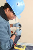 Electrician using voltmeter — Stock Photo