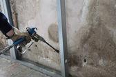 Man spraying inslation into walls — Stock Photo