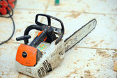 Chain-saw on construction site — Stock Photo
