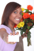 Florist showing business card female — Stock Photo
