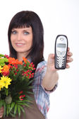 Florist with phone — Stock Photo