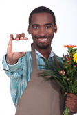Male florist with business card — Stock Photo