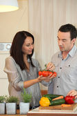 Couple debating which vegetables to cook — Stock Photo