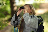 Senior woman on a mountain hike — Stock Photo