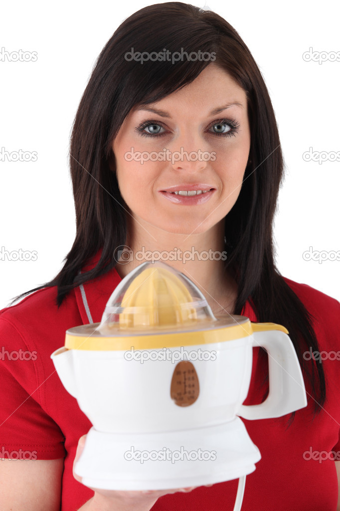 Woman holding squeezer — Stock Photo #10851265
