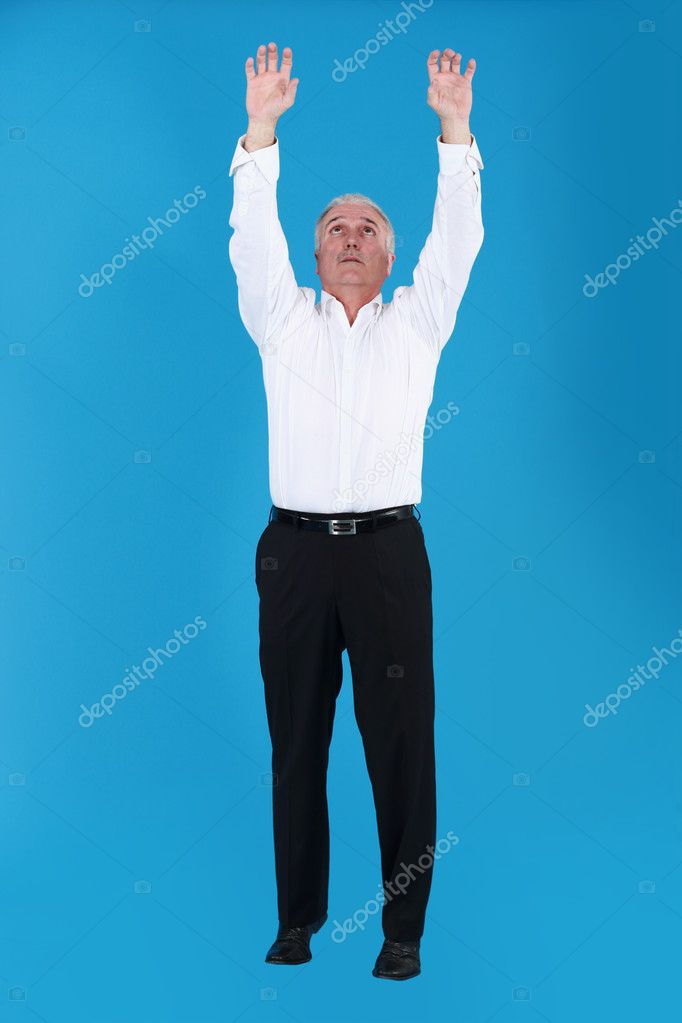 Man reaching for the sky  Stock Photo #10852937