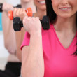 Women working out with dumbbells — Stock Photo