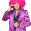 Stock Photo: Min Seventies costume and crazy wig on cellphone
