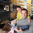 Father and daughter reading a book — Stock Photo #10862231