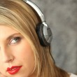 Blond woman listening to music — Stock Photo #10862457