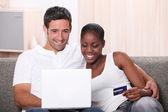 Couple shopping on the Internet — Stock Photo