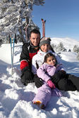 Family on a skiing holiday — Stock Photo