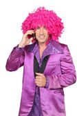 Man in Seventies costume and crazy wig on cellphone — Stock Photo
