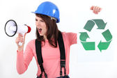 Woman increasing recycling awareness — Stock Photo