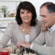 Middle-aged couple playing chess — Stock Photo #10882462