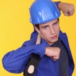 Tradesman holding a mallet on his shoulders — Stock Photo #10883329