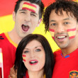 Friends supporting the Spanish soccer team - Stock Photo