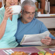 Mature couple having breakfast — Stok fotoğraf