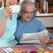 Mature couple having breakfast — ストック写真