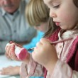 Stock Photo: Little boy and girl painting