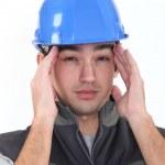 Workman having migraine — Stock Photo