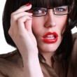 Stock Photo: Sophisticated brunette with spectacles and red lips
