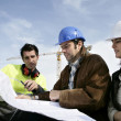 Royalty-Free Stock Photo: Construction workers discussing plans