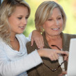 Mother and daughter on the computer — Stock Photo