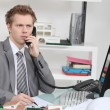 Stock Photo: Architect taking telephone call