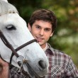 Teen with white horse — Stock Photo #10885494