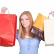 Redhead girl with bags — Stock Photo