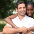 Stock Photo: Mixed-race couple at park