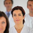 Nurse standing with colleagues — Stock Photo