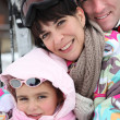 Family on a ski vacation - Stock Photo