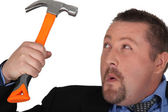 Businessman holding a hammer — Stock Photo