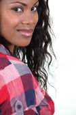 Pretty young woman in a checked shirt — Stock Photo