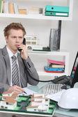 Architect taking a telephone call — Stock Photo