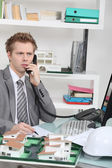Architect taking a telephone call — Stock Photo