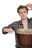 Man playing a djembe drum — Stock Photo