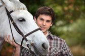 Teen with white horse — Stock Photo