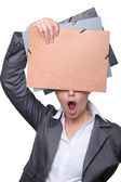 Open-mouthed woman hiding behind office folders — Stock Photo
