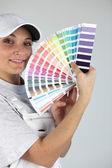 Female decorator with paint swatch — Stok fotoğraf