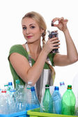 Woman recycling batteries and plastic bottles — Stock Photo