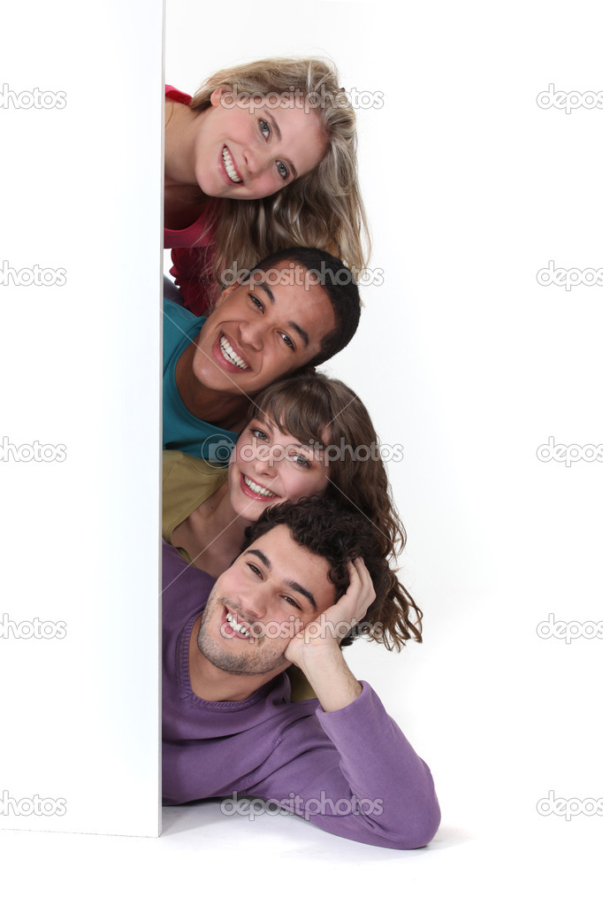 Friends laying by blank advertising — Stock Photo #10882131