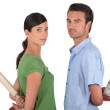 Man and woman with rolling pin — Stock Photo