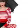 Surprised woman with an umbrella — Stock Photo