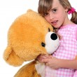 Girl with teddy bear — Stock Photo #10894299