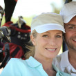 Couple playing a round of golf — Stock Photo