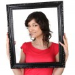 Brunette womwith black picture frame — Stock Photo #10895425