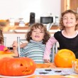 Stock Photo: Girls with pumpkins